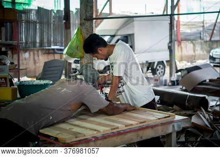 Bangkok, Thailand - May 1, 2020 : Unidentified Carpenter Build Furniture Or Products From Slat And T