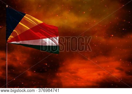Fluttering Seychelles Flag Mockup With Blank Space For Your Data On Crimson Red Sky With Smoke Pilla