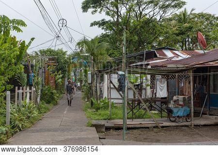 Tortuguero Village, Costa Rica-march 21, 2017: Footpath With Unidentified People In The Tortuguero V