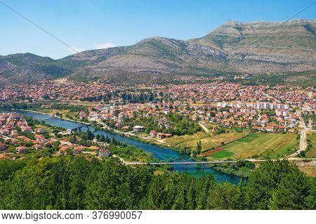 Bosnia And Herzegovina, Republika Srpska. View Of Trebinje City And Trebisnjica River On Sunny Summe