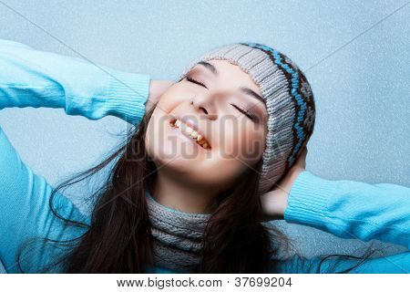 happy woman on blue snowy background