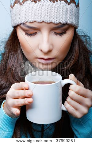woman in hat with hot tea