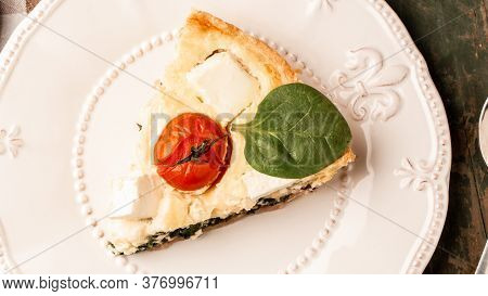 Homemade Spinach French Pie Quiche Lorraine On Wooden Board. Food Recipe Background. Space For Text.