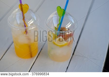 Two Glasses Of Cold Summer Drinks. Glasses With Mojito On A White Wooden Table. Summer Concept. Cold
