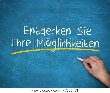 Man writing entdecken sie ihre moglichkeiten with a chalk on blue background poster