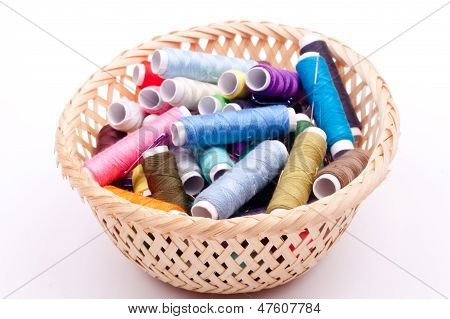 spool of threads in a basket