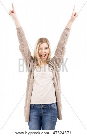 Beautiful blonde woman really happy with both arms on the air, isolated over white background
