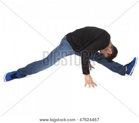 Young Man Stretching Legs On White Background