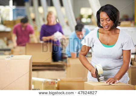 Workers In Warehouse Preparing Goods For Dispatch