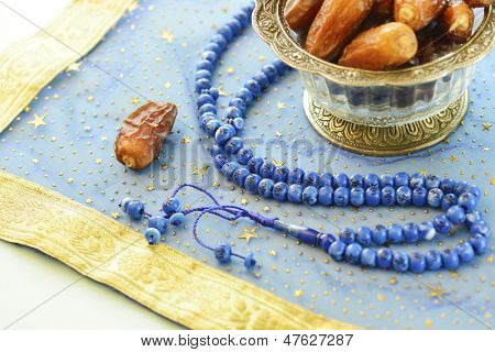 Close up of dates and islamic rosary