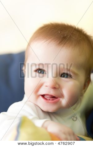 Portrait Of Joyful Blue-eyes Baby