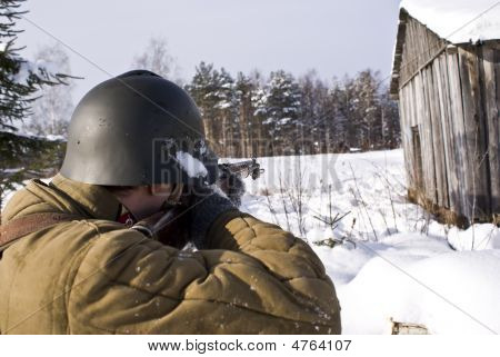 Soviet-finnish War 1939-1940: Red Army Soldier Aims From A Rifle. Kind From A Back