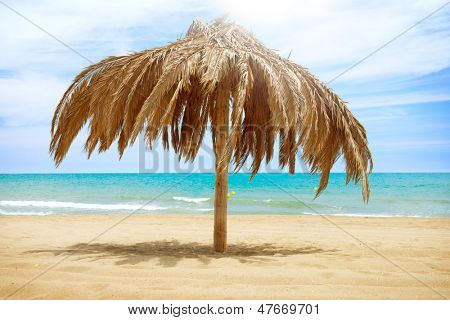 Vacation Concept. Palapa Sun Roof Beach Umbrella in Torremolinos, Spain. Costa del Sol