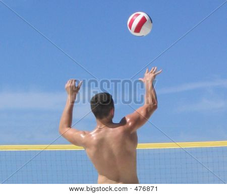 Boy Serving Volleyball
