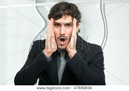 Portrait of an astonished businessman