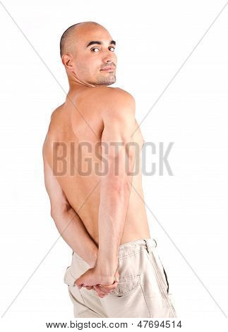 Bodybuilder posing showing his triceps. Isolated on white. poster
