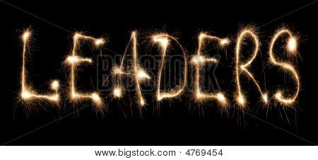 Word leaders written sparkler on a black poster