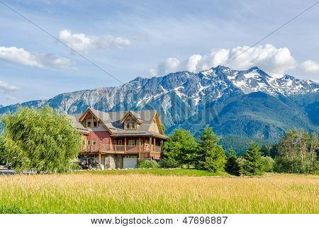 Luxury house over fantastic mountain view at sunny day in Vancouver, Canada.