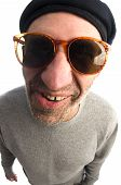 senior middle age man funny face twisted mouth wearing artist french hippie beret hat macro close up distorted large nose poster