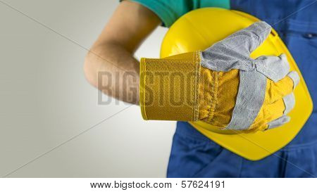 Workman Wearing A Glove Holding A Hardhat
