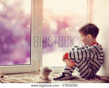 boy in winter window