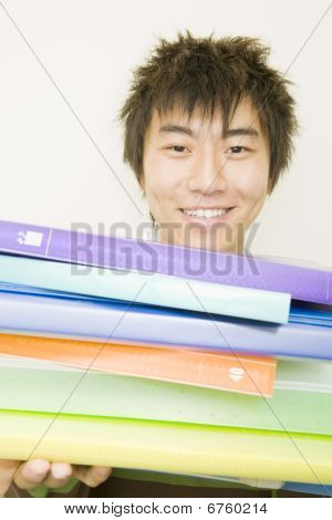 Young Man Holding Colorful Notebooks