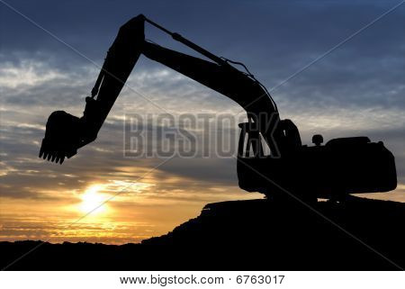 Loader Excavator Over Sunset