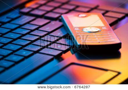 Mobile Phone On Keyboard