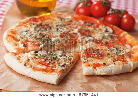 Italian funghi pizza, classic recipe with mushrooms, cheese and tomato
