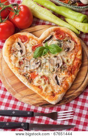 Heart shaped funghi pizza, classic italian recipe