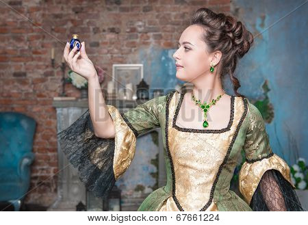 Beautiful Woman In Medieval Dress With Little Bottle