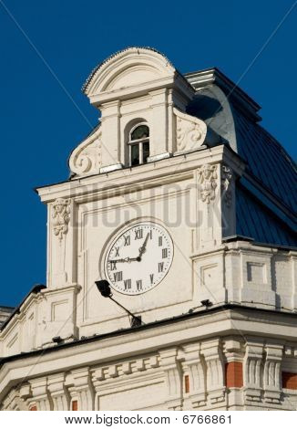 Hours On A Facade Of A Building