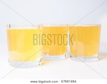 Glasses of pineapple juice on continental breakfast table poster