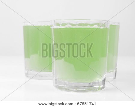 Glasses of green apple juice on continental breakfast table poster