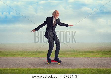 Senior Man Riding A Skateboard