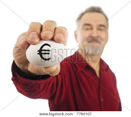 Euro Currency Symbol (€) on white nest egg held by mature man.