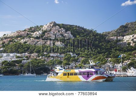 Tourist Glass Bottom Boat And Homes Perching On The Hills Above Port Andratx