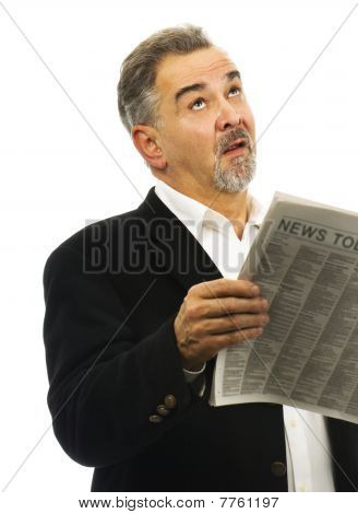 Man Looks Skyward After Reading Newspaper With Look Of Despair