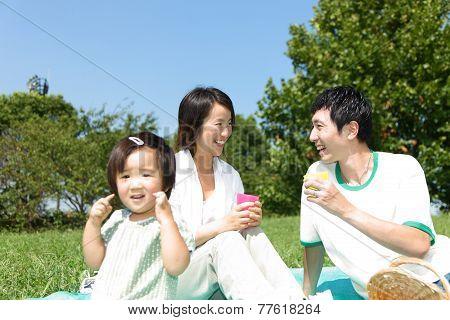 Japanese familiy of three enjoy Picnic