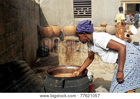 A Woman Takes Care Of The Cooking