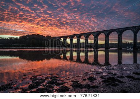 Sunrise with viaduct silhouette