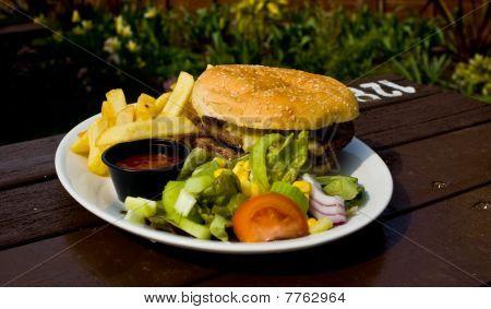burger, chips and side salad
