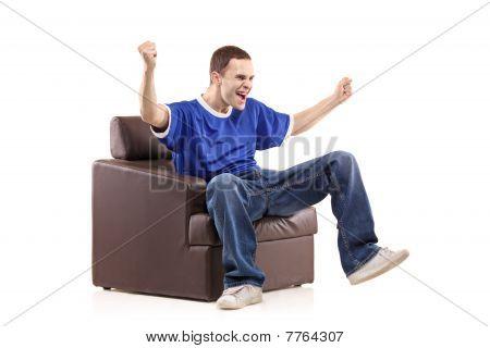 A sport fan sited in a chair