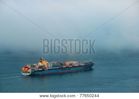 San Francisco, CA - MAY 11: Cargo ship pass by San Francisco bay in fog on May 11, 2014 in San Francisco. SF is the most densely settled large city in California and the second-most in US.
