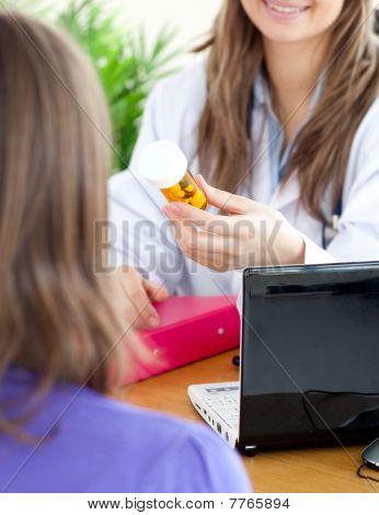 Close-up Of A Cute Female Doctor Holding Medicine