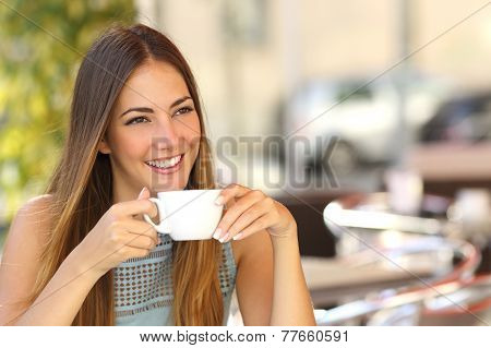 Pensive Woman Thinking In A Coffee Shop Terrace