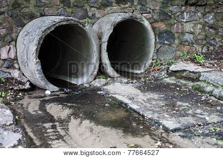 Two Run-off Pipes Discharging Water
