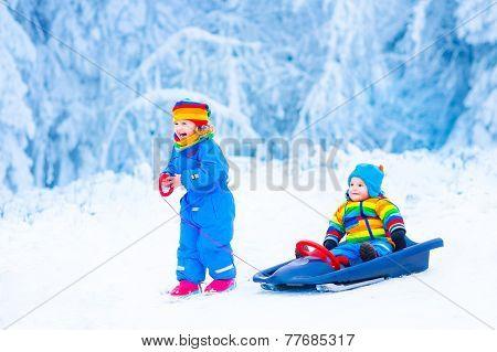 Little Children Enjoying A Sleigh Ride