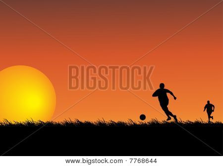 Silhouettes Of Two People Playing Soccer