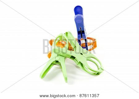 Different Plastic Clothes pins on white background